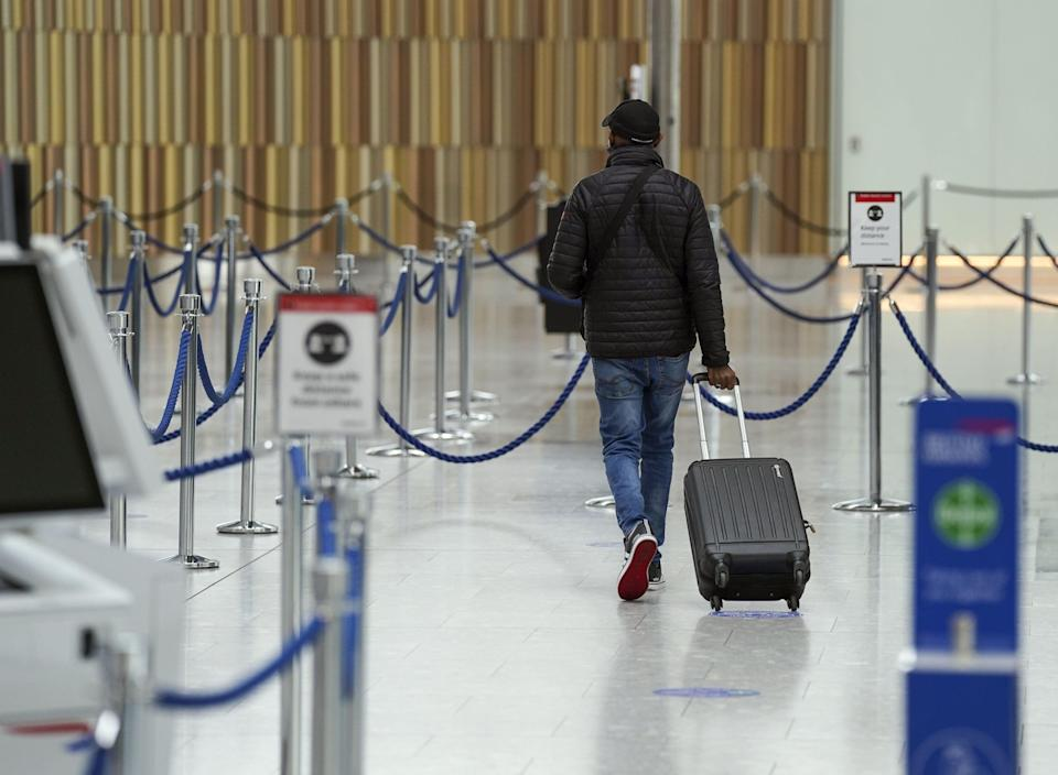 A traveller at Heathrow Airport (Steve Parsons/PA) (PA Wire)