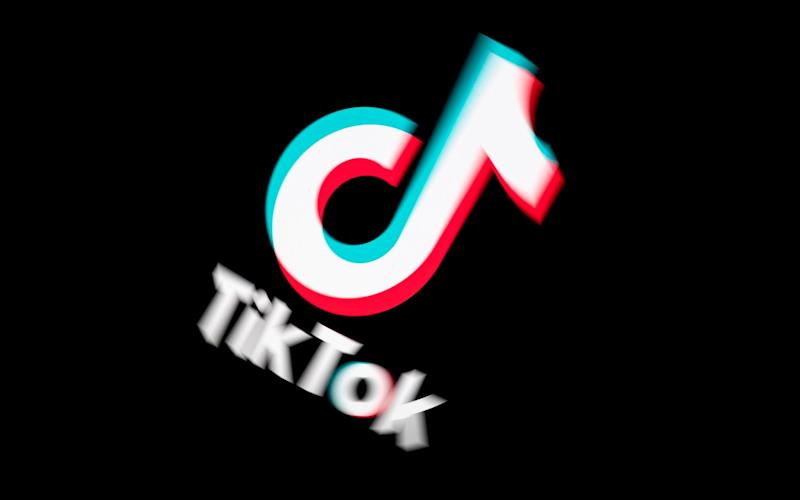 In this file photo taken on November 21, 2019 shows the logo of the social media video sharing app Tiktok displayed on a tablet screen in Paris - Lionel Bonaventure/AFP