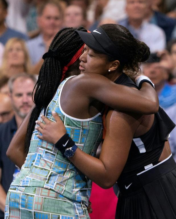 Top-seeded defending champion Naomi Osaka, right, hugs Coco Gauff after defeating the 15-year-old American on Saturday at the US Open (AFP Photo/Don Emmert)
