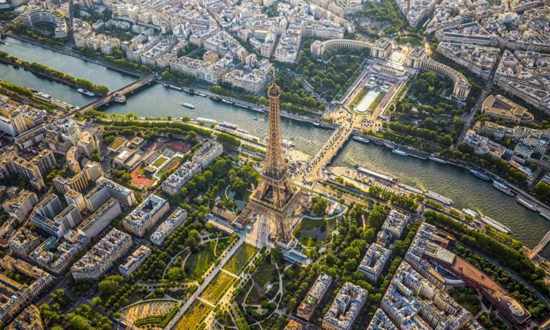 See the Eiffel Tower on an interactive tour to the viewing platform of the 324-metre structure, plus a helicopter's view of the tower against the Paris skyline.