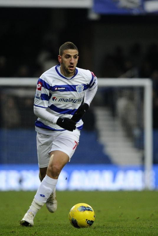 "Queens Park Rangers' Moroccan midfielder Adel Taarabt runs with the ball during the English Premier League football match between Queens Park Rangers and Wolverhampton Wanderers at Loftus Road in London, England on February 4, 2012. RESTRICTED TO EDITORIAL USE. No use with unauthorized audio, video, data, fixture lists, club/league logos or ""live"" services. Online in-match use limited to 45 images, no video emulation. No use in betting, games or single club/league/player publications (Photo by Miguel Medina/AFP/Getty Images)"