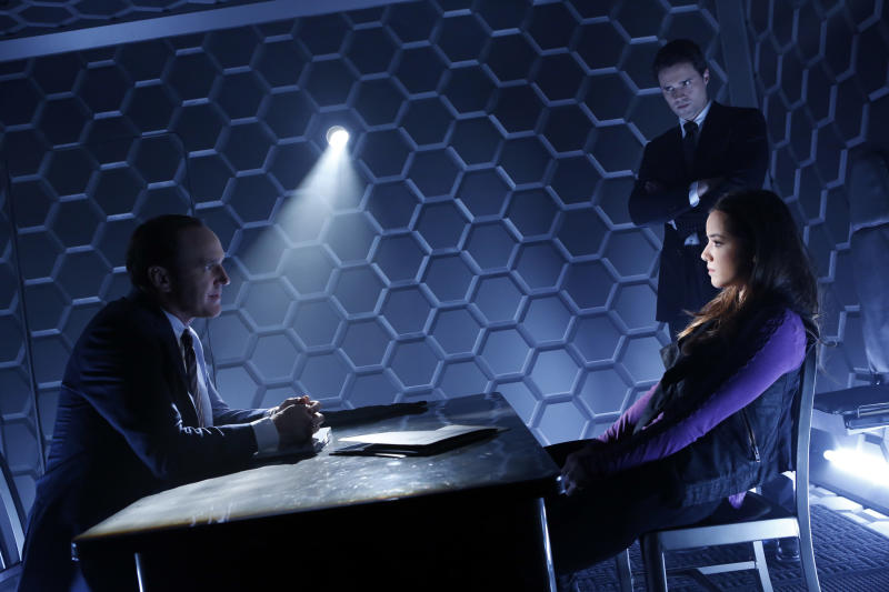 """This publicity image released by ABC shows Clark Gregg, left, Brett Dalton, standing, and Chloe Bennet in a scene from """"Marvel's Agents of S.H.I.E.L.D.,"""" a new series picked up by ABC for the 2013-2014 season. (AP Photo/ABC, Bob D'Amico)"""