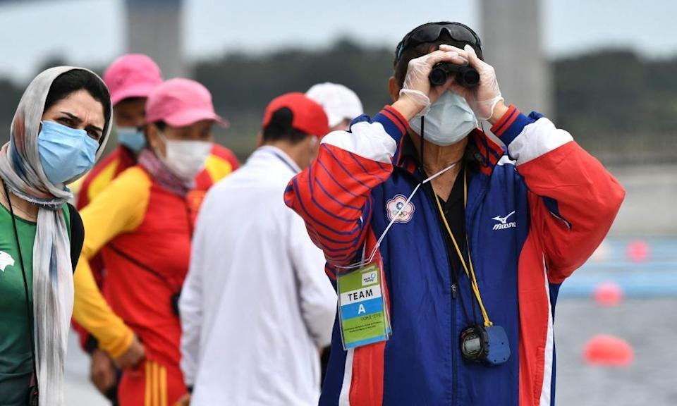 A Thai rowing coach watches a qualification event in Tokyo this month.