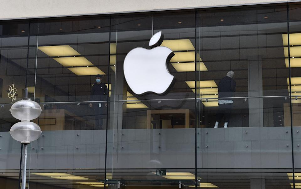 <p>Logo of US tech giant Apple can be seen on an Apple store in Munich, southern Germany</p> (AFP via Getty Images)