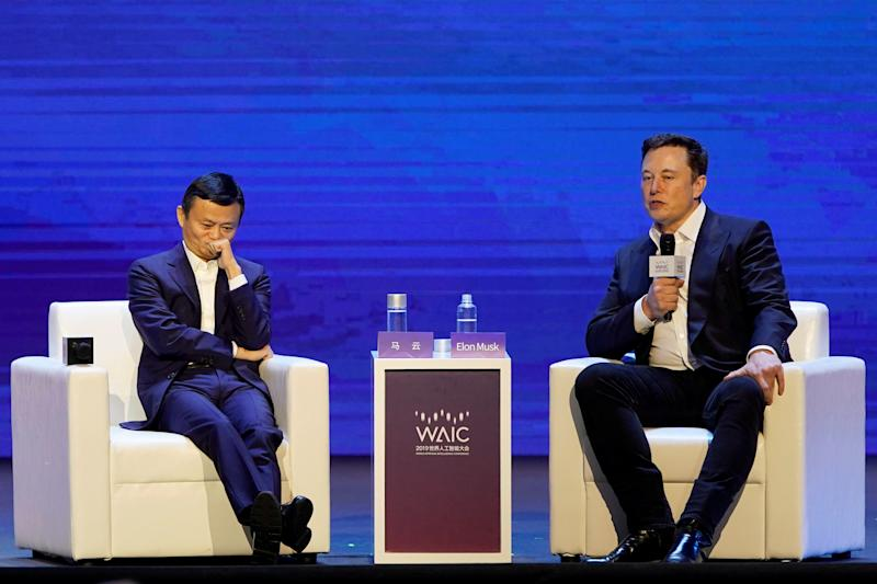 Tesla Inc CEO Elon Musk and Alibaba Group Holding Ltd Executive Chairman Jack Ma attend the World Artificial Intelligence Conference (WAIC) in Shanghai, China, August 29, 2019. REUTERS/Aly Song