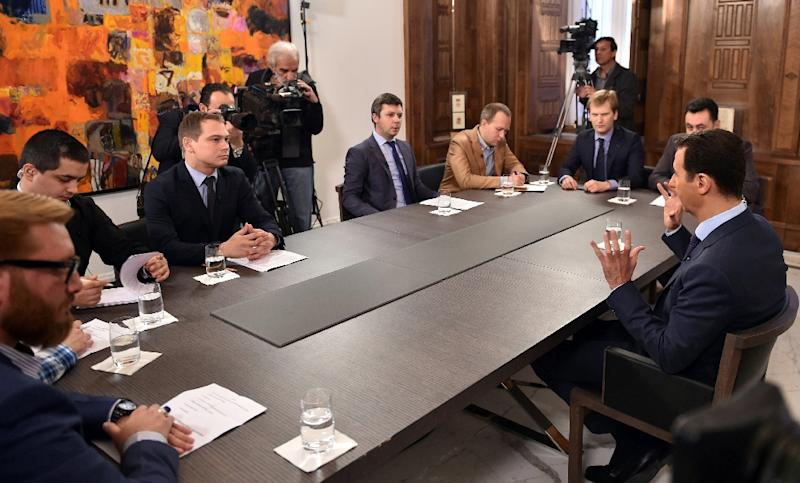 A picture released on March 27, 2015 by the official Syrian Arab News Agency (SANA) shows Syrian President Bashar al-Assad (R) giving an interview to journalists from various Russian media outlets in the capital Damascus (AFP Photo/)