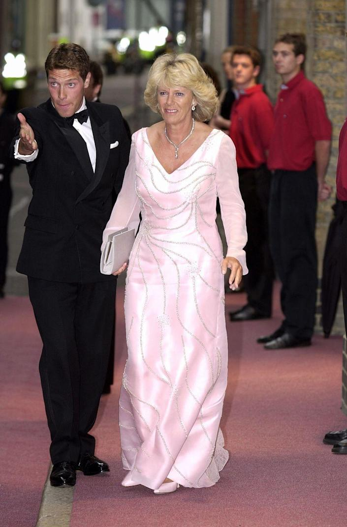 <p>At the gala dinner for The Prince's Trust, a charity founded by Prince Charles, Camilla chose a floorlength pink satin gown with long sheer sleeves and delicate beading. </p>