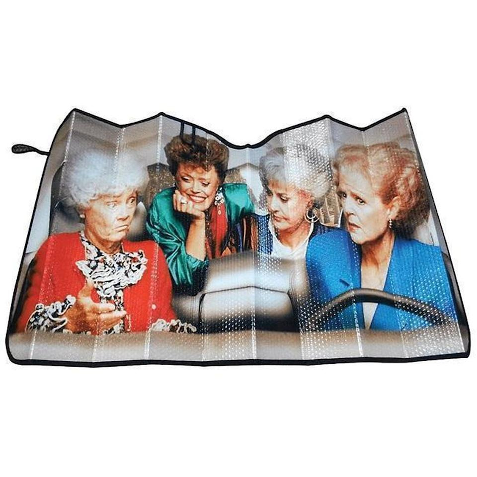 "<h2>Golden Girls Windshield Sunshade</h2>A windshield sunshade that reflects light and your personality. Just because we're living through a pandemic doesn't mean we can't enjoy the little things.<br><br><br><strong>FYE</strong> Golden Girls Sunshade, $, available at <a href=""https://go.skimresources.com/?id=30283X879131&url=https%3A%2F%2Fwww.fye.com%2Fgolden-girls-sunshade-fye.000000841092122252.html"" rel=""nofollow noopener"" target=""_blank"" data-ylk=""slk:FYE"" class=""link rapid-noclick-resp"">FYE</a>"