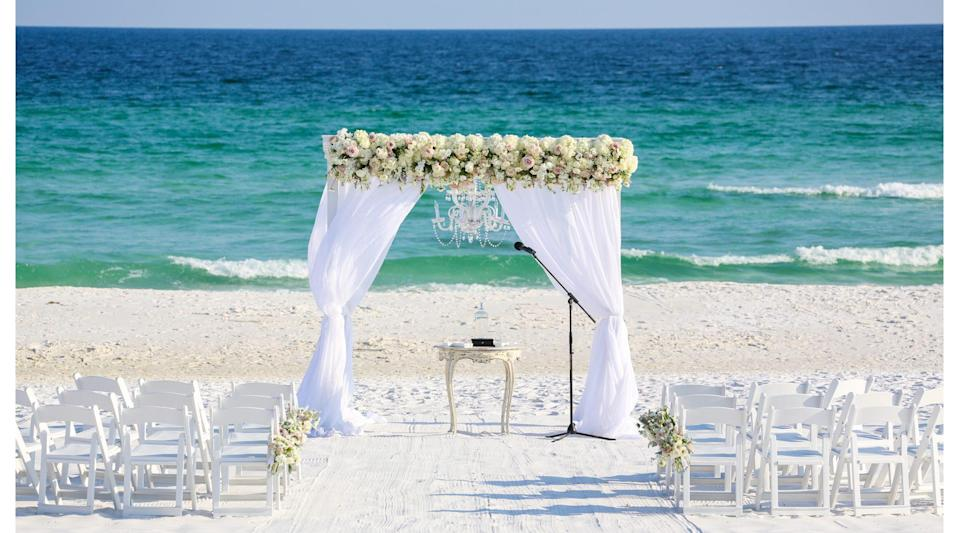 """<p>Consistently voted as one of the most romantic places to stay in Florida, <a href=""""https://www.hendersonbeachresort.com"""" rel=""""nofollow noopener"""" target=""""_blank"""" data-ylk=""""slk:The Henderson"""" class=""""link rapid-noclick-resp"""">The Henderson</a> feels like a hidden treasure, thanks to its 1.3 miles of private beach and the state park next door. The Henderson works with couples to plan ceremonies right on the sugar-sand beaches of the Gulf, or on any one of the manicured green spaces like the grand lawn or beachside green, both of which are adjacent to the beach and state park. For the reception, take your pick of one of two magnificent ballrooms, the poolside patio, or on the rooftop terrace, which features panoramic views of the shore and city.</p>"""