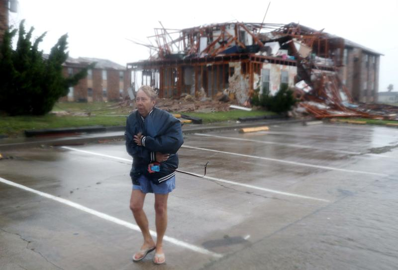 Jacque McKay walks through the apartment complex where she lives in Rockport.