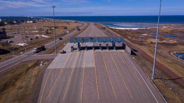 With border restrictions extended another two weeks, the toll booths at Confederation Bridge will remain quiet. (Shane Hennessey/CBC - image credit)