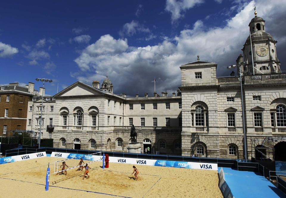 Teams from Spain and the Netherlands take part in a practice session ahead of the FIVB Beach Volleyball test event for the London 2012 Olympic Games at Horse Guards Parade in London August 8, 2011. REUTERS/Luke MacGregor
