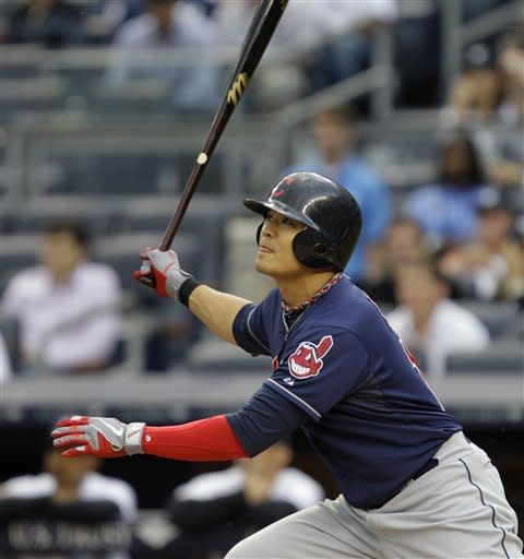 Cleveland Indians' Shin-Soo Choo flies out to left during the first inning against the New York Yankees in a baseball game at Yankee Stadium in New York, Monday, June 25, 2012. (AP Photo/Kathy Willens)