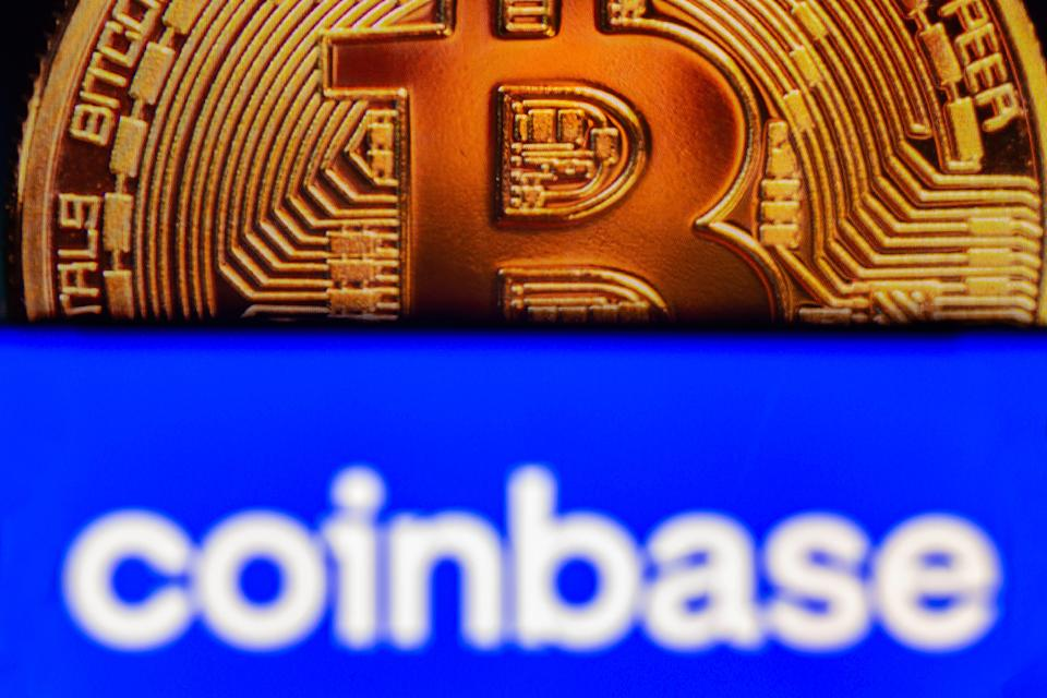 BRAZIL - 2021/08/06: In this photo illustration the Coinbase logo seen displayed on a smartphone screen, in the background, a bitcoin cryptocurrency is displayed. (Photo Illustration by Rafael Henrique/SOPA Images/LightRocket via Getty Images)