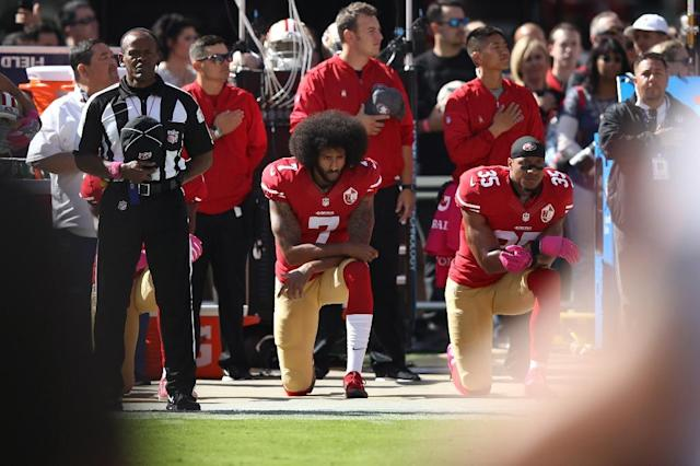 (FILES) This file photo taken on October 23, 2016 shows Eric Reid #35 and Colin Kaepernick #7 of the San Francisco 49ers kneeling in protest during the national anthem prior to their NFL game against the Tampa Bay Buccaneers at Levi's Stadium in Santa Clara, California. Former San Francisco 49ers quarterback Colin Kaepernick, an NFL free agent who last year began the kneeling protest during US anthems that became a major controversy, has filed a collusion grievance against the NFL, according to multiple reports on October 15, 2017. (AFP Photo/EZRA SHAW)