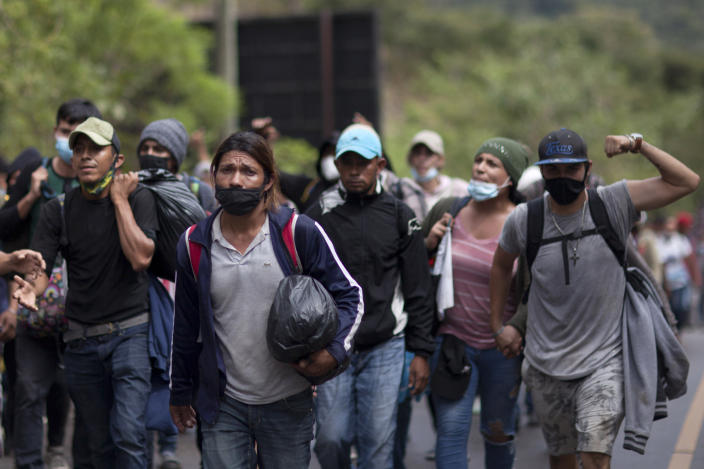 Migrants hoping to reach the U.S. border walk alongside a highway in Chiquimula, Guatemala, Saturday, Jan. 16, 2021. Guatemalan authorities estimated that as many as 9,000 Honduran migrants have crossed into Guatemala as part of an effort to form a new caravan to reach the U.S. border. (AP Photo/Sandra Sebastian)