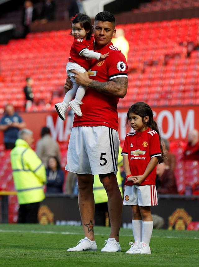 "Soccer Football - Premier League - Manchester United vs Watford - Old Trafford, Manchester, Britain - May 13, 2018 Manchester United's Marcos Rojo with children after the match REUTERS/Darren Staples EDITORIAL USE ONLY. No use with unauthorized audio, video, data, fixture lists, club/league logos or ""live"" services. Online in-match use limited to 75 images, no video emulation. No use in betting, games or single club/league/player publications. Please contact your account representative for further details."