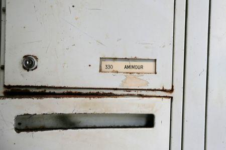 "A name on letter box reading ""Amimour"" is seen at the entrance of an apartment building where Samy Amimour, one of the attackers identified by the police, grew up in the Parisian suburb of Drancy, France, November 17, 2015.  REUTERS/Gonzalo Fuentes"