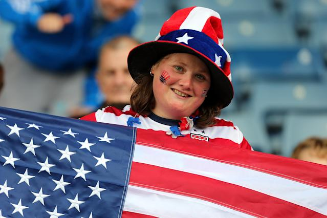 GLASGOW, SCOTLAND - JULY 28: A USA fan holds an American flag during the Women's Football first round Group G match between United States and Colombia on Day 1 of the London 2012 Olympic Games at Hampden Park on July 28, 2012 in Glasgow, Scotland. (Photo by Stanley Chou/Getty Images)