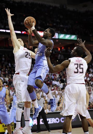 North Carolina guard P.J. Hairston, center, goes to the basket against Maryland center Alex Len (25) and James Padgett (35) during the first half of an NCAA college basketball game, Wednesday, March 6, 2013, in College Park, Md. (AP Photo/Nick Wass)