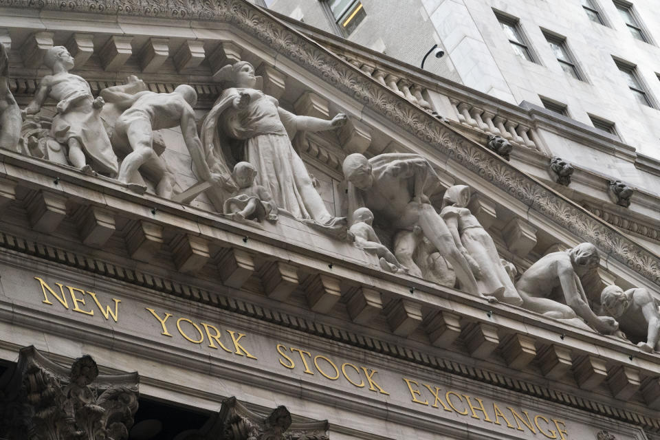 FILE - Stone sculptures adorn the New York Stock Exchange, Thursday, Nov. 5, 2020, in New York. Stocks are opening lower on Wall Street, Thursday, Nov. 19, as mounting coronavirus infections and evidence of the damage being cause to people's livelihoods rolls in. (AP Photo/Mark Lennihan, File)