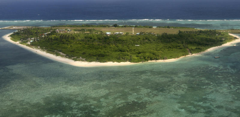 """FILE - This July 20, 2011, file photo shows an aerial view of Pag-asa Island, part of the disputed Spratly group of islands, in the South China Sea located off the coast of western Philippines. A senior U.S. official says the presence of large numbers of Chinese vessels near islands and islets occupied by the Philippines is """"a concern."""" The Philippine government protested the Chinese ship movements Thursday, April 4, 2019, after its military monitored more than 200 Chinese vessels from January-March in a disputed area named Sandy Cay, which is near the Philippine-occupied island of Pag-asa. (Rolex Dela Pena/Pool Photo via AP, File)"""