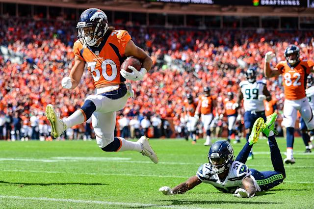 <p>Running back Phillip Lindsay #30 of the Denver Broncos scores a first quarter touchdown on a reception as cornerback Tre Flowers #37 of the Seattle Seahawks falls to the ground during a game at Broncos Stadium at Mile High on September 9, 2018 in Denver, Colorado. (Photo by Dustin Bradford/Getty Images) </p>