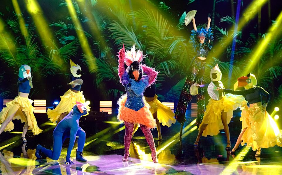 """Exotic Bird, center, performs with a flock of backup dancers on Fox's """"The Masked Dancer,"""" a spinoff of """"The Masked Singer."""""""