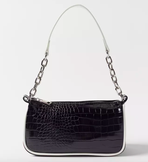 Tessa Faux Leather Baguette Bag in black with silver chain detail. Image via Urban Outfitters.