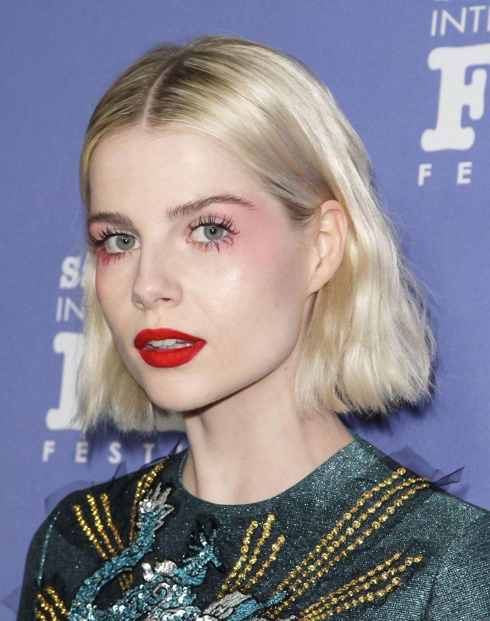 <p>Seriously fresh skin was the perfect base for Lucy Boynton's neon pink high blusher and clashing matte red lipstick.</p>