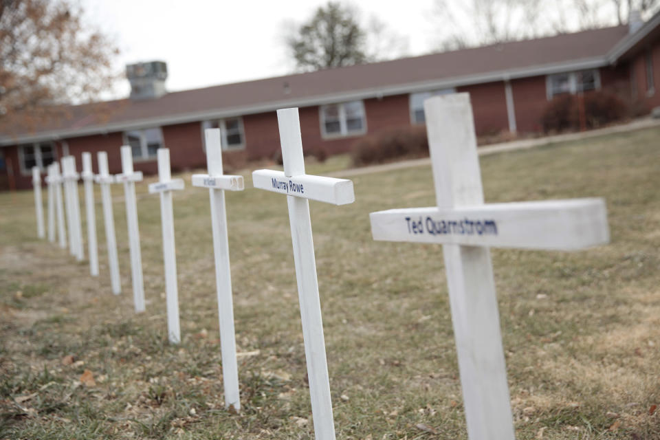 FILE - In this Dec. 8, 2020 file photo, white crosses on the lawn of Good Samaritan Society nursing home in Canton, S.D., commemorate residents who have died in recent weeks from the coronavirus. (AP Photo/Stephen Groves)