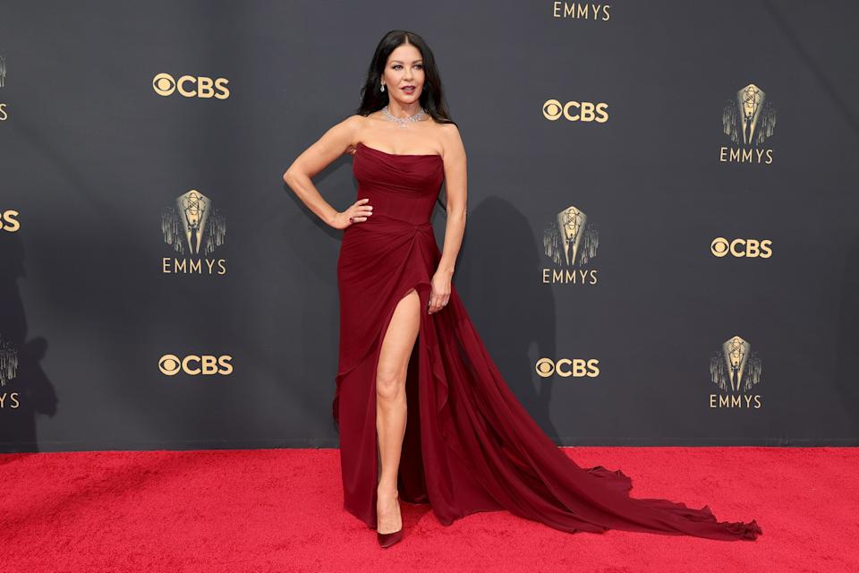 The glamorous actor looked every bit the star in her dark red strapless gown with a high slit.
