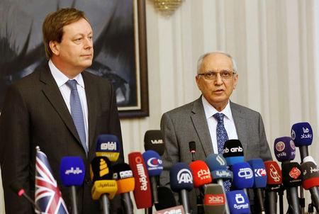 Razzak al-Essa speaks during news conference at the Ministry of Finance in Baghdad