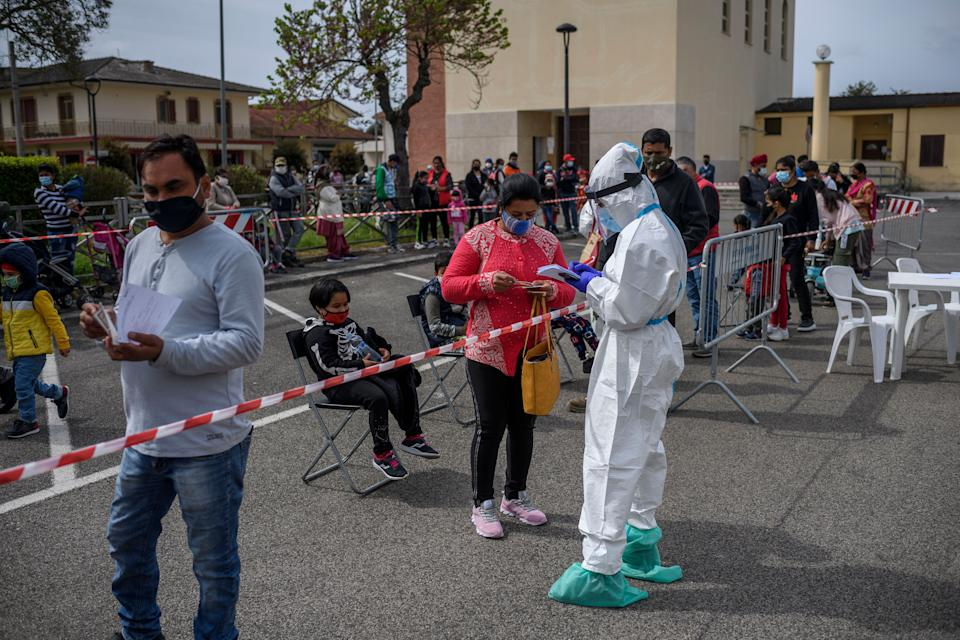 TERRACINA, ITALY - MAY 03: Members of the Indian community wait in line to receive a Covid-19 swab test in the Borgo Hermada neighbourhood, which is home to around 2500 Indian people, on May 3, 2021 in Terracina, Italy (Photo: Antonio Masiello via Getty Images)