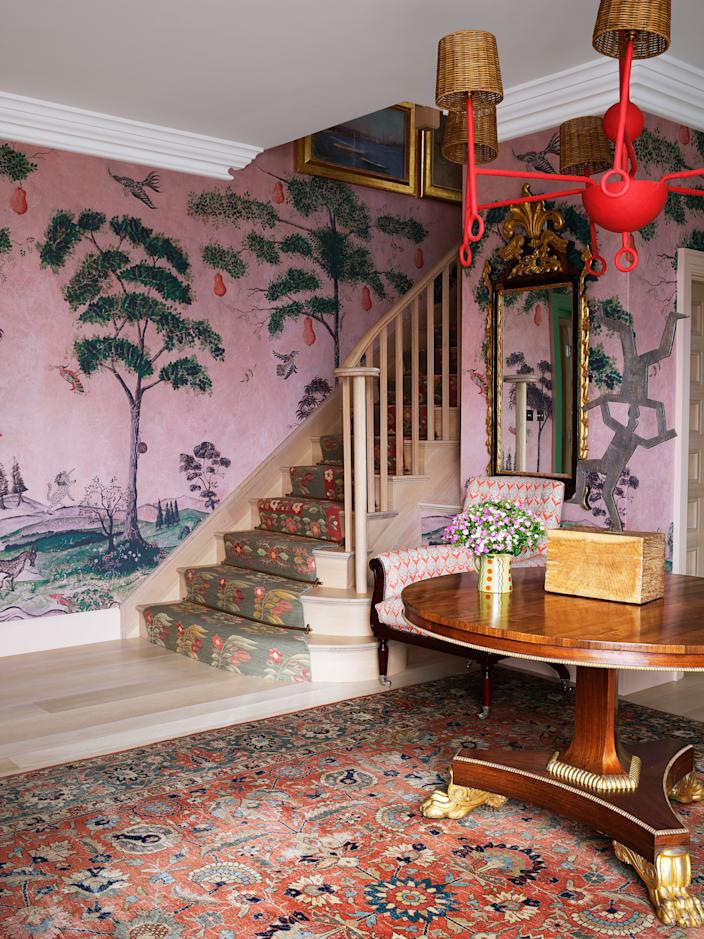 """<div class=""""caption""""> In the entry, flat-weave rugs were fashioned into a stair runner, antique mirror. </div> <cite class=""""credit"""">Simon Upton </cite>"""