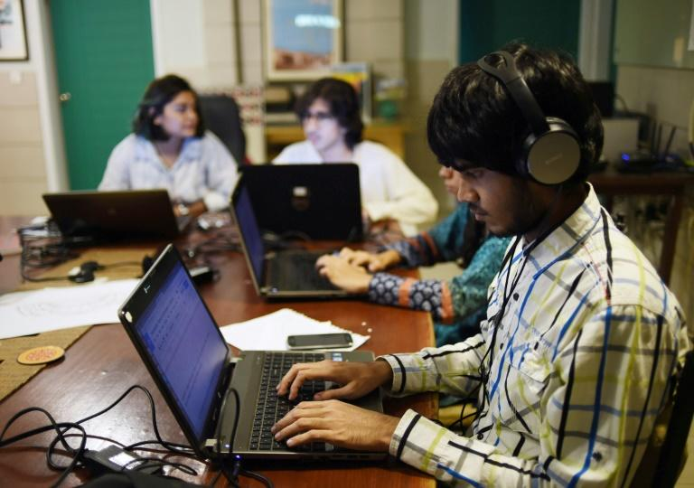 Pakistani volunteers transcribe interviews and testimonies of people who migrated from India to Pakistan at the time of partition at their office of the Citizen Archive of Pakistan in Karachi