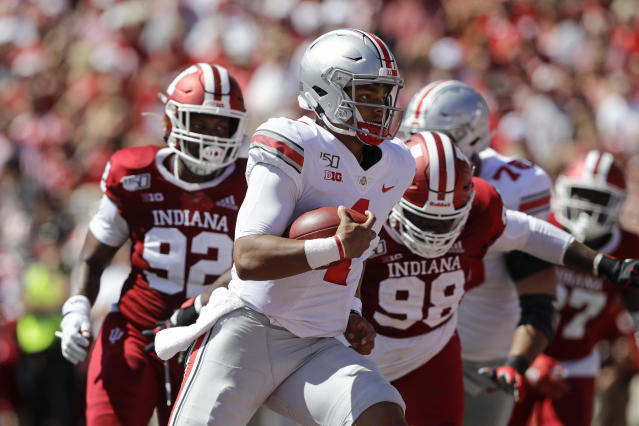 Ohio State quarterback Justin Fields (1) runs for a touchdown during the first half of an NCAA college football game against Indiana, Saturday, Sept. 14, 2019, in Bloomington, Ind. (AP Photo/Darron Cummings)