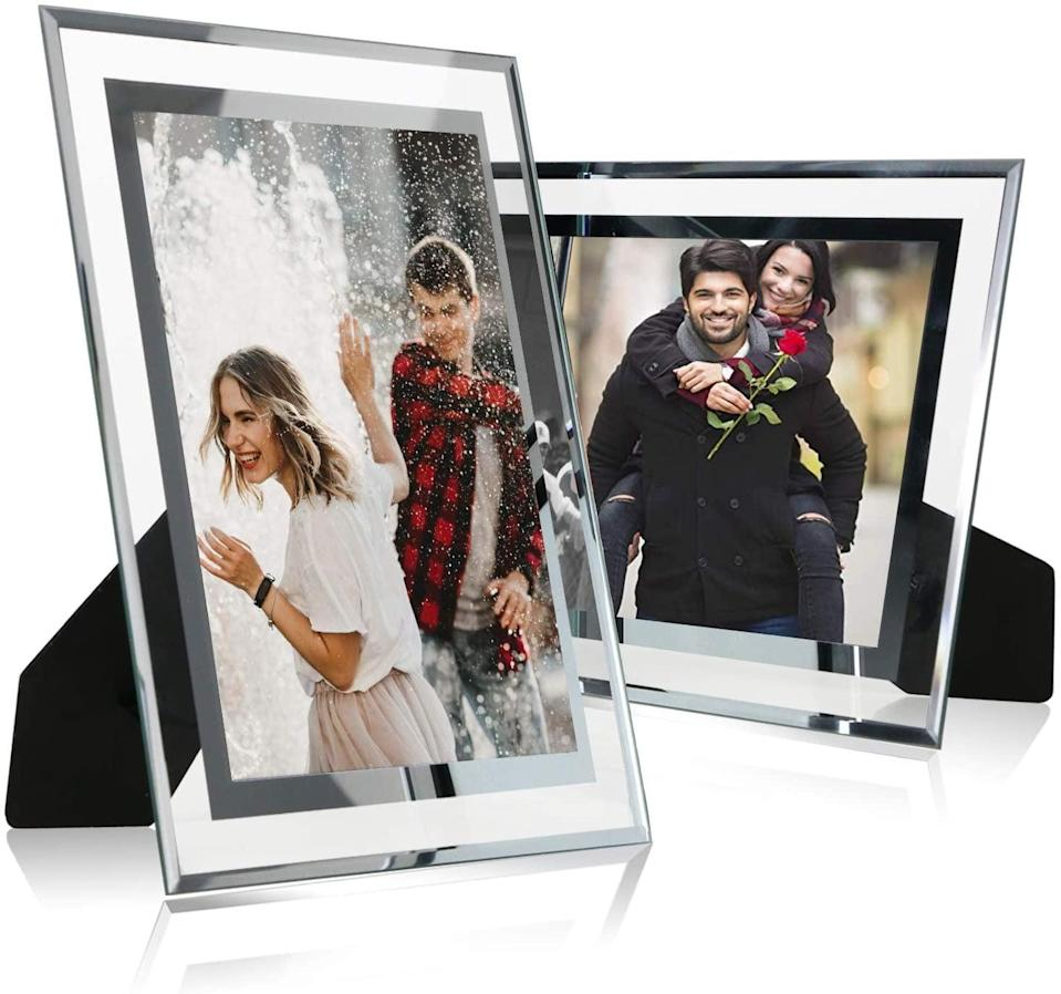 <p>The <span>6x8 Glass Picture Frame, Silver Mirrored For Photo Display Stand on Tabletop, Pack of 2</span> ($17) will go with any aesthetic.</p>