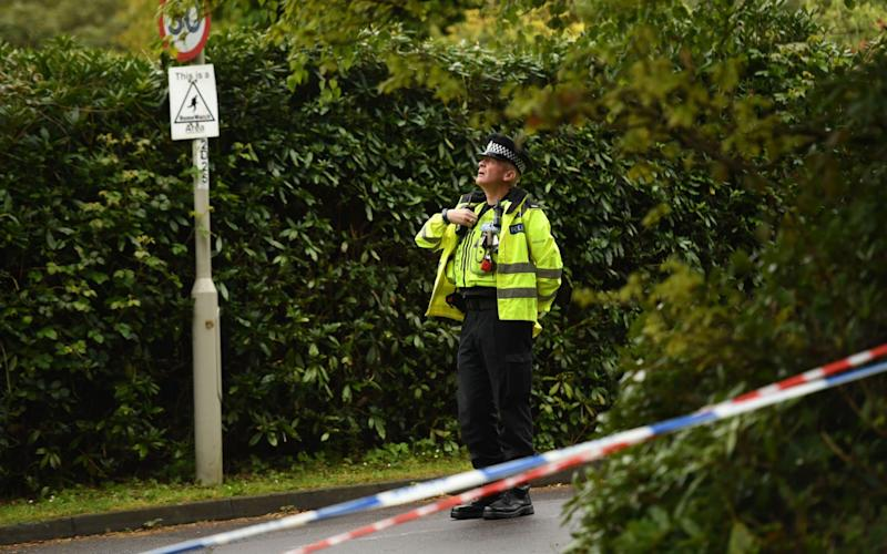 A policeman guards the cordon in St Ives, near Ringwood - Credit:  RUSSELL SACH
