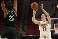 Maryland guard Taylor Mikesell (11) shoots in front of Wagner forward Khaleah Edwards (22) during the second half of an NCAA college basketball game, Tuesday, Nov. 5, 2019, in College Park, Md. Maryland won 119-56. (AP Photo/Nick Wass)
