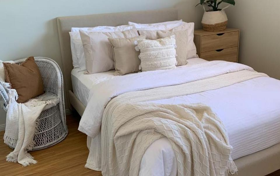 Bedroom with white and beige bedding