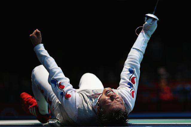 LONDON, ENGLAND - JULY 31: Byungchul Choi of Korea celebrates winning his match against Jianfei Ma of China during the quaterfinals of the Men's Foil Individual on Day 4 of the London 2012 Olympic Games at ExCeL on July 31, 2012 in London, England. (Photo by Hannah Johnston/Getty Images)