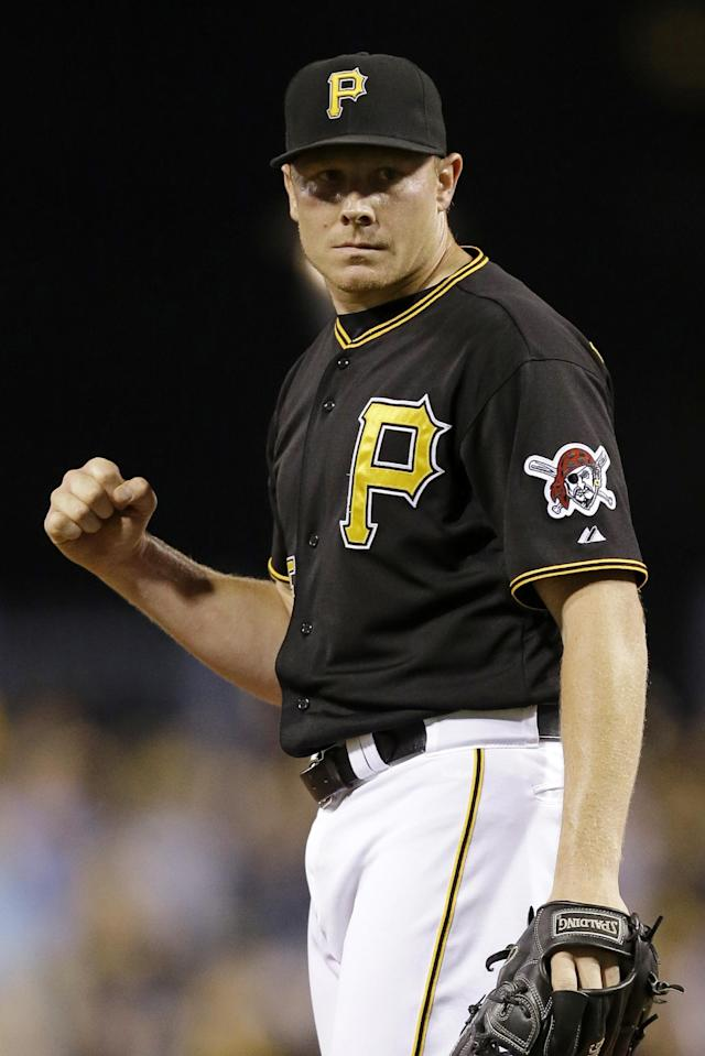 Pittsburgh Pirates closer Mark Melancon celebrates after getting the final out of a 3-1 win over the Chicago Cubs in a baseball game in Pittsburgh, Thursday, Sept. 12, 2013. (AP Photo/Gene J. Puskar)