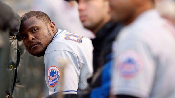 PHOTO: In this June 21, 2008 file photo, New York Mets second baseman Luis Castillo rests his head against the dugout rail in the eighth inning of the Colorado Rockies' 7-1 victory over the Mets in a Major League baseball game in Denver. (David Zalubowski/AP, File)