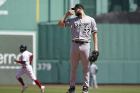 Chicago White Sox starting pitcher Lucas Giolito reacts after giving up a solo home run to Boston Red Sox's Enrique Hernandez, left, in the first inning of a baseball game at Fenway Park, Monday, April 19, 2021, in Boston. (AP Photo/Elise Amendola)