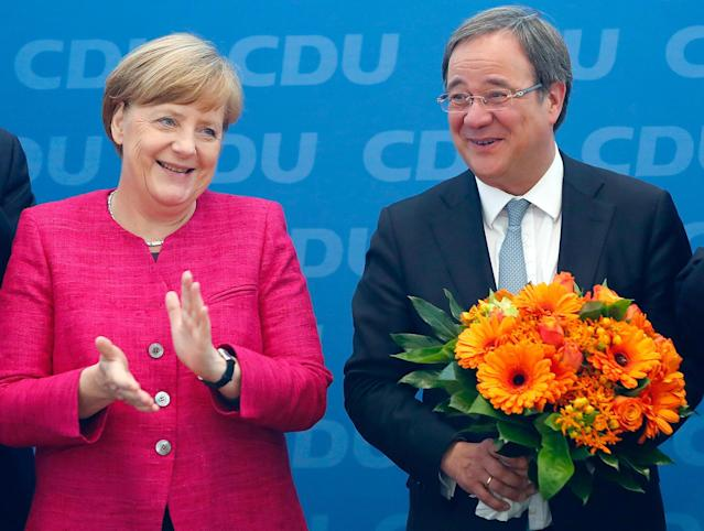 <p>Armin Laschet, top candidate of the Christian Democratic Union (CDU) receives flowers from German Chancellor Angela Merkel after the regional state elections of North Rhine-Westphalia, in Berlin, Germany, May 15, 2017. (Photo: Fabrizio Bensch/Reuters) </p>