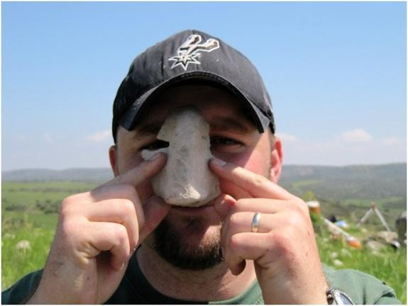 Fragments of facemasks, like this one, were discovered in the 3,300-year-old cult complex at Tel Burna.