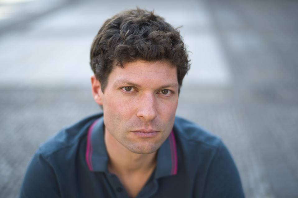 Author and journalist Ronen Steinke poses for a portrait in Berlin, Germany, Wednesday, Sept. 23, 2020. Ronen Steinke wrote the book 'Terror against Jews' where he demanded authorities increase security for Jews and their institutions in Germany. (AP Photo/Markus Schreiber)