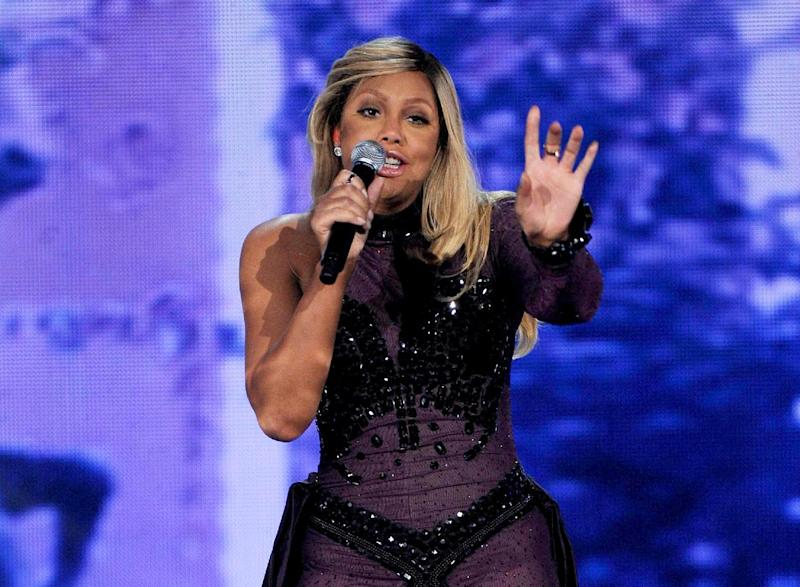 """FILE - This Nov. 8, 2013 file photo shows Tamar Braxton performing at the 2013 Soul Train Awards at the Orleans Arena in Las Vegas. Braxton is nominated for three honors at Sunday's Grammy Awards, including best urban contemporary album for her first album in 13 years, """"Love and War."""" The title track is also nominated for best R&B song and R&B performance. (Photo by Frank Micelotta/Invision/AP, File)"""