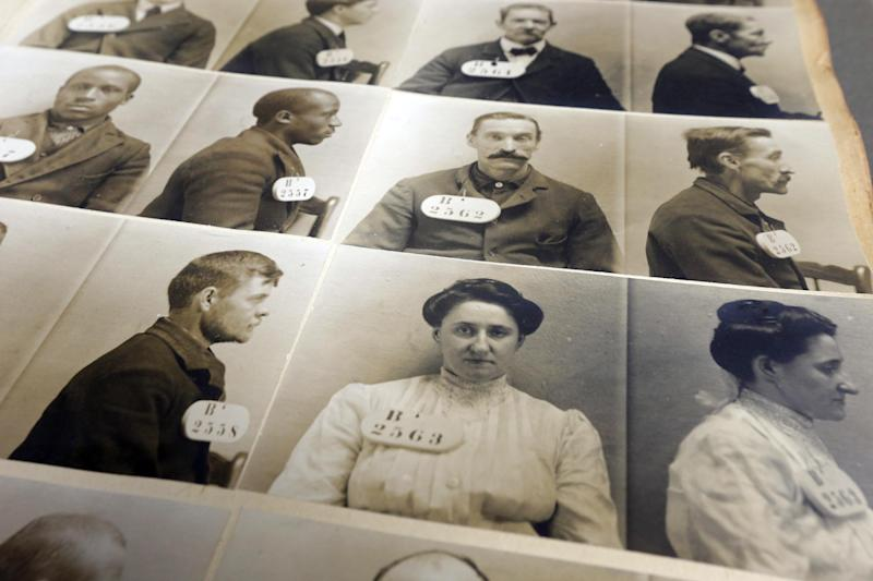 """In this Tuesday, March 12, 2013 photo, shown is an excerpt out of the Eastern State Penitentiary 1904-1906 mug shot book in Philadelphia. The defunct and decayed prison that serves as one of Philadelphia's quirkiest tourist attractions, plans to displaying dozens of never-before-seen artifacts for 10 days only in a """"pop-up museum."""" (AP Photo/Matt Rourke)"""
